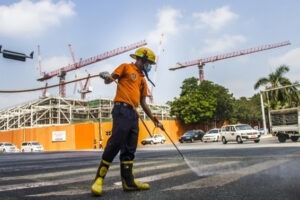 Worker disinfect sprays at the public area of downtown, Kyauktada Township, Myanmar. Photo: Mar Naw
